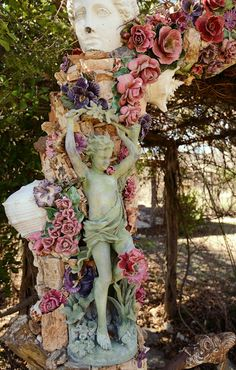 MP Ranch Exterior... Fab Archway with Majolica Roses and Cherubs!
