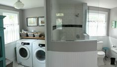 Light fixture in laundry room, half glass walls, black accent in octagon and dot floor