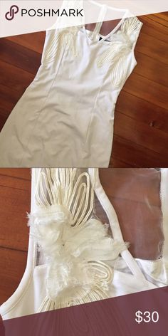 White Party Dress White. Worn only once. Excellent condition. Looks like something from LF -- cannot remember which boutique it was purchased at. LF Dresses Mini