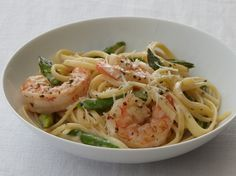 This one-dish pasta recipe is company-worthy – bright green asparagus, plump shrimp and tender linguine in a savory cream sauce. #christmas #newyears