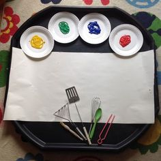 It's been a few weeks since we've had the paints out here so this afternoon I decided to change it up a bit and set up painting with kitchen utensils in the tuff tray. G was a bit unsure at first about being allowed to use kitchen equipm.