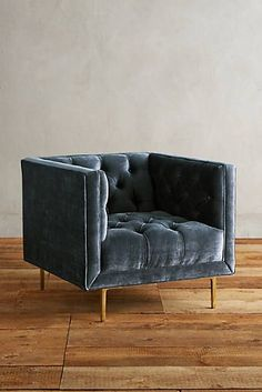 Inviting, channel-tufted sides and a plumped bench cushion soften the sleek silhouette of this classic tuxedo shape. Marryn Chair