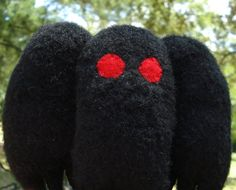 It's a Mothman plush! Handmade from black faux fur and felt, with red felt eyes, he is 6 inches tall and 6 inches wide. Mothman, Cryptozoology, Red Felt, Diy Clay, Cuddling, Plushies, Toys, Diy Ideas, Handmade