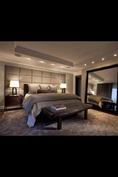 Classy, Relaxing Bedroom... very modern. The lighting is a really cool idea