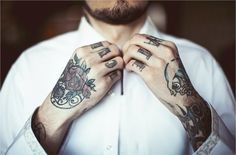 Knuckles and hand tatts.
