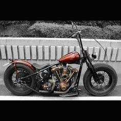 Bobber Motorcycle with Redish Tins and a Black Frame