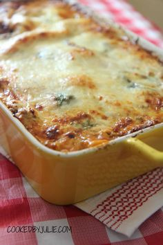 This is the ultimate lasagna recipe! Made with a cheesy bechamel sauce and sweet tomatoes, this lasagna is tender, melt-in-your-mouth goodness!