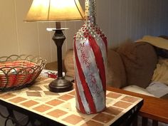 Lighted wine bottle, Christmas theme crafted using Gallery Glass, Rhinestones and 20 strand Xmas lights.