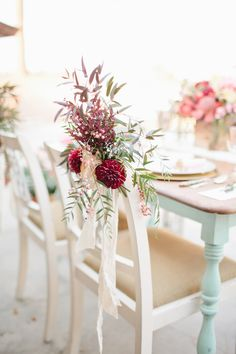 a flower for the reception chairs, photo by Megan Welker Photography, styling by Beijos Events http://ruffledblog.com/garden-romance-wedding-inspiration #weddingideas #dahlias