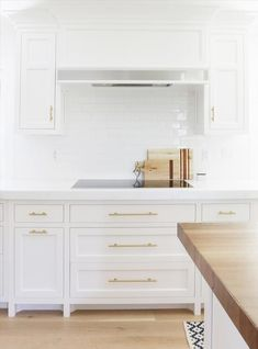 White Kitchen Cabinets with Long Brass Pulls, Transitional, Kitchen, Benjamin Moore Chantilly Lace