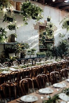 Botanical glasshouse wedding reception. A florist shop by day and an event space by night.