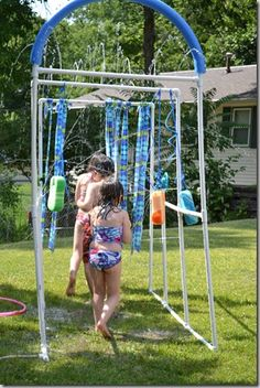 Laura and Mere: PVC pipes are CHEAP!!!! A dad or husband or whoever could drill the holes!!  Make your own Kiddie Car Wash #diy #craft #summer