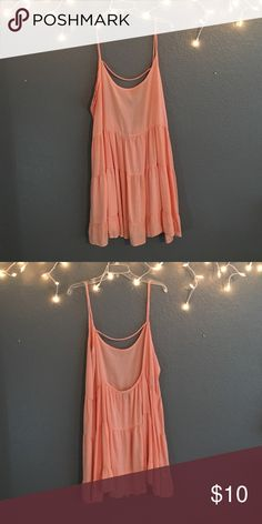 WET SEAL CORAL DRESS❤️ Get it now, before it's too late! Wet seal has closed! Comfy, low back, coral dress from Wet Seal! It's very flattering and has a tier effect. Size L. Wet Seal Dresses Mini