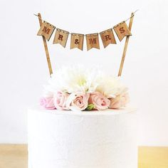 Mr & Mrs Cake Topper is expertly crafted and engraved on laser-cut wood. A vintage addition to your weddingcake. Bunting will need to be assembled Supplie