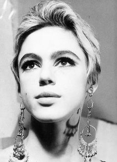 Edie Sedgwick. I might have to start wearing overly uge earrings now, she does it so effortlessly.