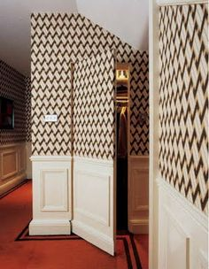 Wallpaper over the closet and bathroom doors. Integrated doors! I think this could be cool for a hidden door or a door to an attic or bathroom closet or something!