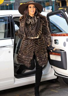 Kim k wearing fur coat