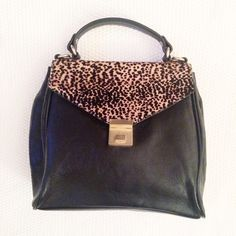 Zara Handbag Still in excellent condition!! Only used a few times. Attachable crossbody/shoulder strap. Black leather with leopard detail on top. Gold hardware. Zara Bags
