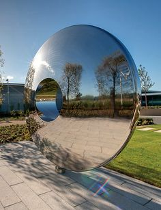 Looking at the Torus contemporary sculpture from the side, showing reflections by David Herber.