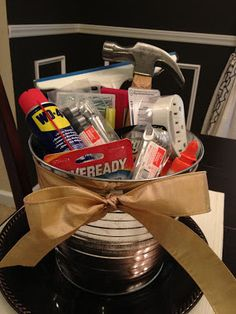 House warming gift idea - a his and hers basket with necessities   It was full of all kind of goodies for a new homeowner, such as Goo Gone, batteries, a hammer, wood glue, super glue, nails, screws, a squeegee for the shower, etc. So fun!