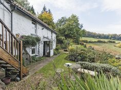 This period cottage was once a cider mill, and a donkey was used to transport the produce up and down the hill.