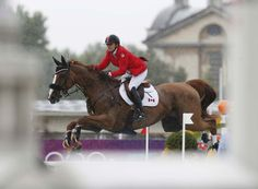 Canada's Jill Henselwood rides George during the equestrian individual jumping second qualifier at the London 2012 Olympic Games