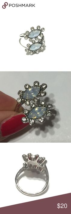Gorgeous JLo Opalite ring Brand new in package. Size 7. Great gift for yourself or someone special. Great addition for Opal jewelry collection .  Jennifer Lopez Jewelry Rings