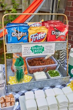 Walking Tacos party food | ENO Hammock Party Ideas from AmysPartyIdeas.com | Birthday Party Ideas for Tweens, Teens | Hang Out Party Ideas | Camping party ideas, portable s'mores, bug juice, s'mores menu, printable party supplies #birthdaygifts #campingfoodideas