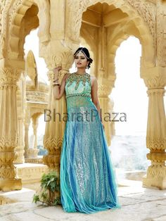 Enamouring sea green and blue color gown planed on net glamorized with golden zari, kundan, diamantes work.  Item code ; GWN806 http://www.bharatplaza.com/new-arrivals/gowns.html