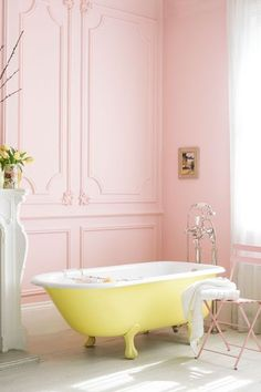 Vintage Bathroom Decor | French Detail Pink Walls | High Ceiling | Yellow and White Claw Foot Tub | Chic Retro Home Decor | Bright and Clean | #fabdecor