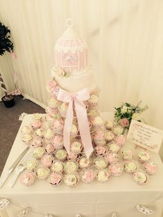 bird cage wedding cake with butterfly cupcakes