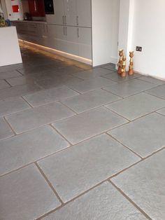 Worn Grey Limestone : Rustic style kitchen by Floors of Stone Ltd