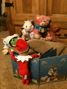 Elf is reading the story of the true meaning of Christmas to some of his friends.