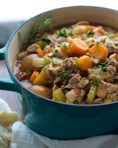 Slow Cooker Tuscan Chicken Stew - A healthy and comforting stew that couldn't be any easier to prepare! The flavors are enhanced by fennel seeds, rosemary, and a splash of balsamic vinegar.  Don't forget a hearty chunk of bread for dipping.