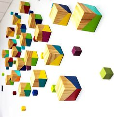 Perspectives, a custom original wall sculpture | 3-d corporate art   Vibrant rich colors in contrast with the rich natural glossed finish of the wood creates a very visually intriguing and fun 3D artwork.  DETAILS:  -3-d wood cubes -Example piece is comprised of 58 total pieces, 2 different sizes -Available in any custom color scheme or size  PROCESS: One by one, each cube is hand glazed, hand painted one side at a time with rich vibrant color, then completely glazed again for a tremendous…