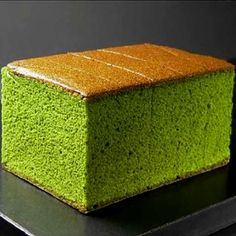 Matcha flavored Japanese castella cake looks delicious with a cup of tea.