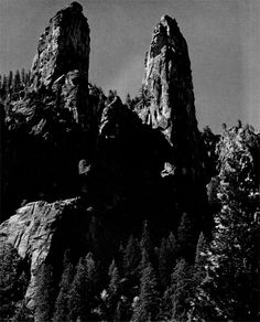 The sharp, jagged rocks of the Cathedral Spires rise 2,154 feet. by Ansel Adams