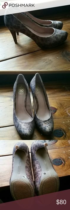Vince Camuto Shimmer Snake Skin Heels Size 7.5 M Brand new, never worn. Size 7.5 M. Beautiful shiny snake skin type heels. Tan, brown, and blacks. When the sun hits these, they look amazing . Very snug fit for a 7.5, so I would consider these not comfy for a 7.5. If you're a 6 ot 6.5 these will be perfect. Heel is approximately 4in. No trades please.  No box or dust bag with these. Vince Camuto Shoes Heels