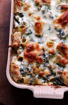 The vegetables outnumber the pasta in this cheesy spring vegetable rigatoni bake, filled with asparagus, Swiss chard, and peas.