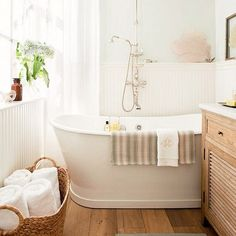 Serene bathroom with tub and wooden details.