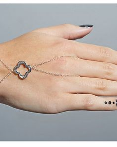 Silver clover hand chain... reminds of the clover jewelry from Heidi Klum's jewelry line.