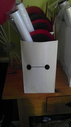 Baymax gift bags for a Big Hero 6 party - just use white bags and draw Baymax face