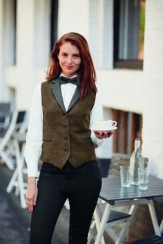 LADIES BROWN TWEED WAISTCOAT (FW0580) Choose rich fabrics with functional design in this wool tweed waistcoat with contrast collar and rever, adjustable back belt for flattering fit and featuring two functional jetted pockets and inbreast pocket.