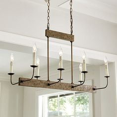 With its trim linear shape, this 8-light chandelier is a perfect fit above a rectangular dining table or kitchen island. Dress it in our tall chandelier shades (sold separately) to soften the lines and add a punch of color. Linear 8-Light Chandelier features:Hand hammered metalMatching rectangular ceiling canopy