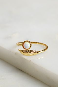 Opal & Leaf Ring Gold,  A dainty ring with a leaf pendant and a circle opal pendant and an open face allowing for a custom fit.