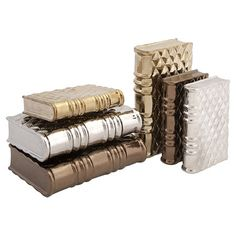 Add a shimmering touch to your entryway console table or living room mantel with this eye-catching book decor set, crafted from ceramic and featuring metalli...