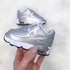 Toddler Nike Air Max 90 Made with SWAROVSKI® Crystals Selected Style: 724823 003 COLOR: Platinum Silver FIT: True to size Select from 2 options: Outside Logos - Both logos facing the outside of the foot *as shown on photos Outside & Inside Logos - Both outside and inside facing