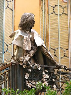 Liszt - Statue of the great Hungarian composer Liszt Ferenc / Franz Liszt, looking down from the balcony of the Archbishopal Palace in Pecs, Hungary.