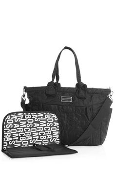 One of our best sellers, the Pretty Nylon Eliz-a-baby is a very convenient and accessible bag for any Mom on-the-go. The Eliz-a-baby is lightweight, machine washable, and features our signature logo plaque detailing. This bag also includes a detachable cross-body strap, and a fold-out for convenient diaper changing.100% Nylon. 17