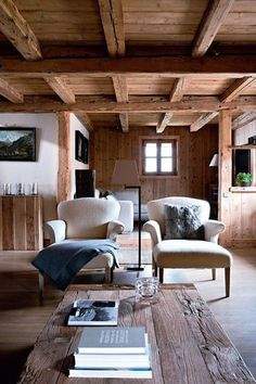 love the combination of exposed wood beams and white walls
